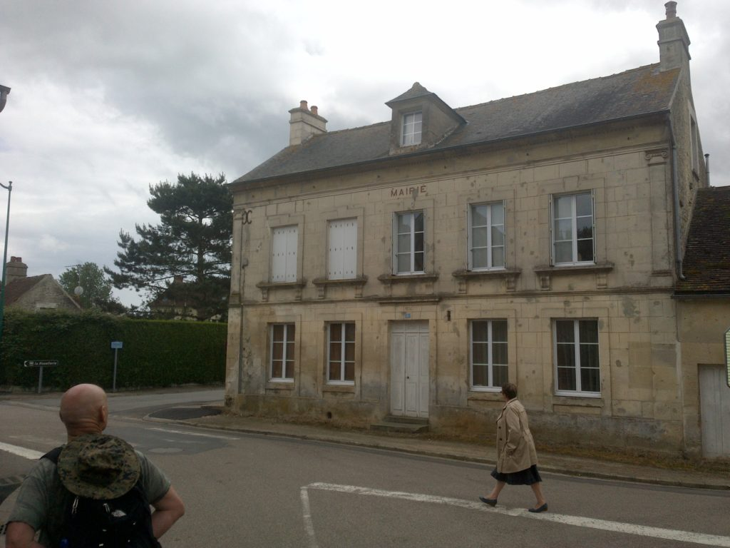"Former town hall (marked ""Mairie"" on the game map), Brendan Clark, bottom left. Note bullet scarring still visible on its façade."