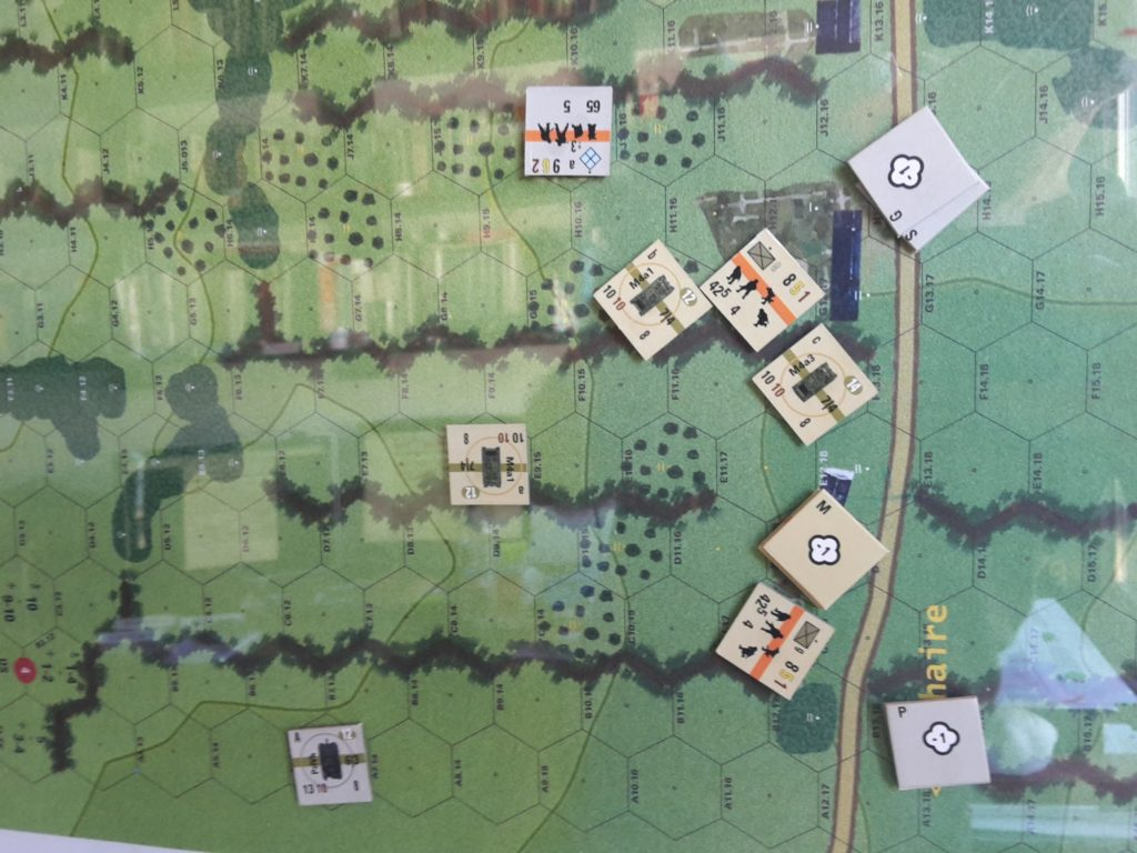 Beginning, Turn 5, third test. Weak initial draw. GER runs a tank down US right, but too late. On GER right, reduced paratroop squad menaces a PzF shot. Germans ahead by 3VP.
